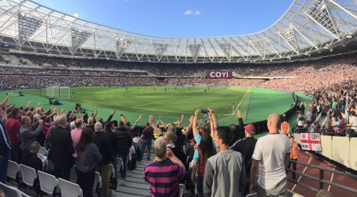 Panorama with bubbles and singing fans at London Stadium, home of West Ham United FC