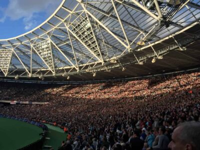 A full stand of supporters at London Stadium, home of West Ham United FC