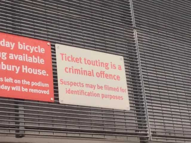 sign that says ticket touting is a criminal offence