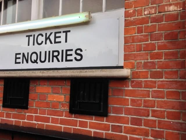 ticket enquiries sign at English soccer stadium
