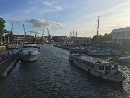 Boats in the Bristol docks at dusk.