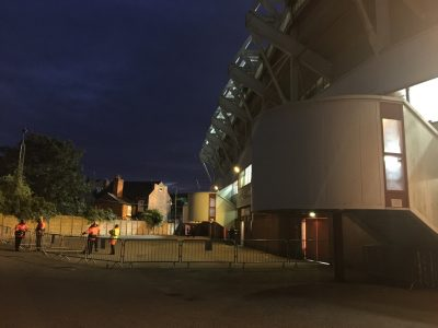 Fulham fans storming the away-end entrance.