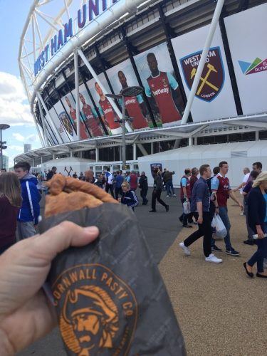 A pasty held up outside London Stadium, home of West Ham United FC
