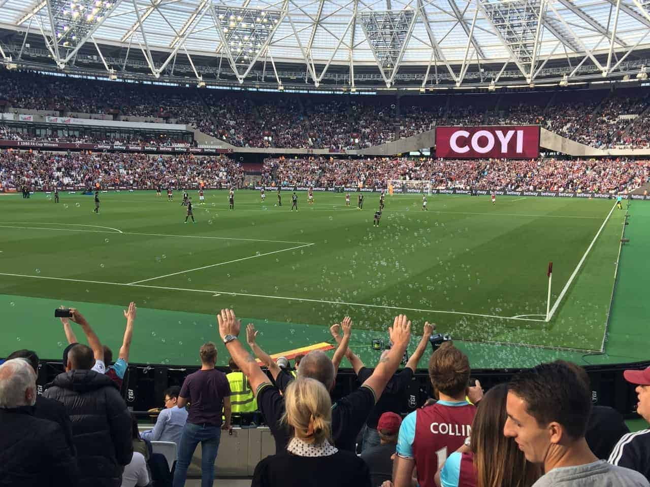 Fans singing and bubbles flying at London Stadium, home of West Ham United FC