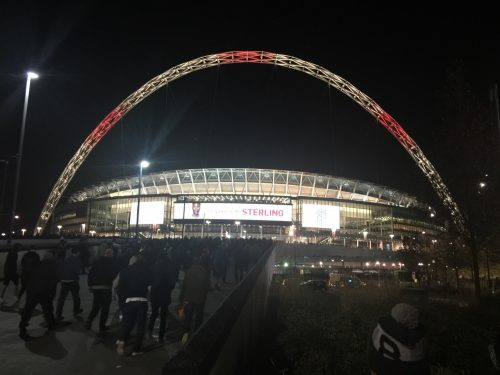 Wembley, lit up in English red and white.
