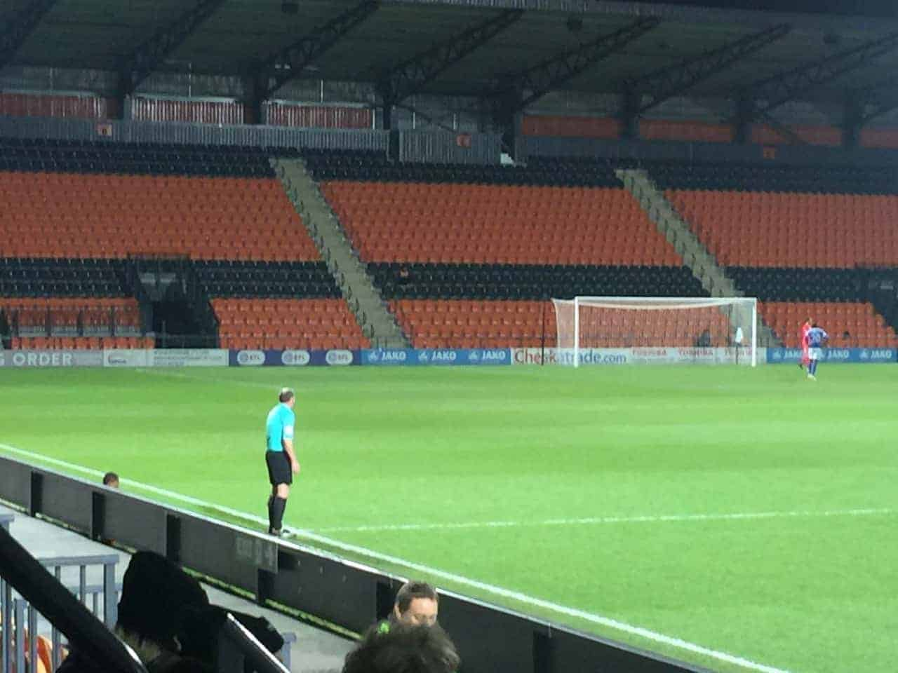 linesman at empty soccer stadium