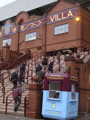 people climbing stairs to enter Villa Park soccer stadium
