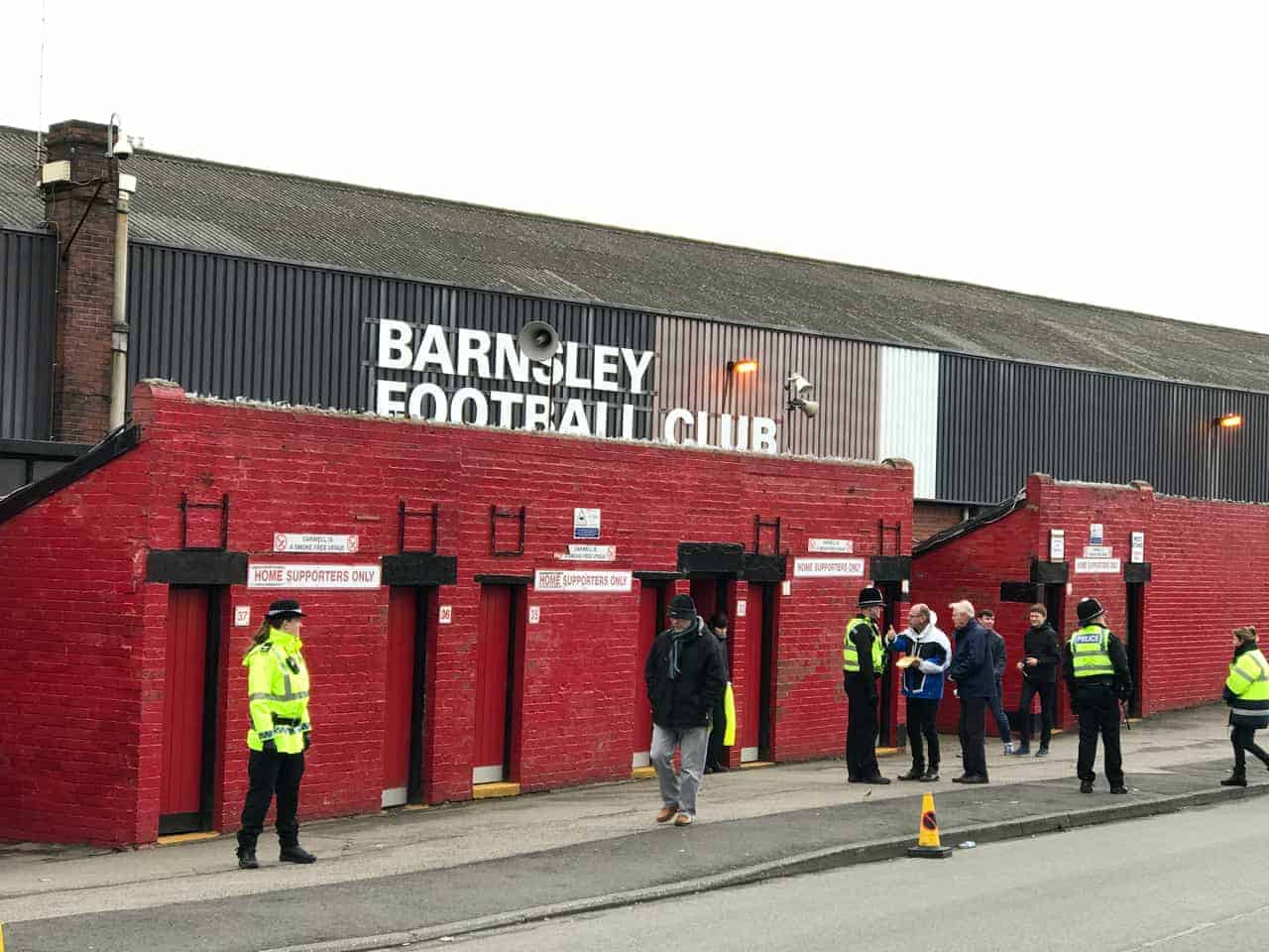security and fans outside barnsley football club