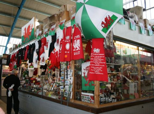 swansea market vendor selling rugby fan gear