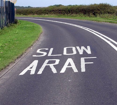 street showing the words slow in english and welsh