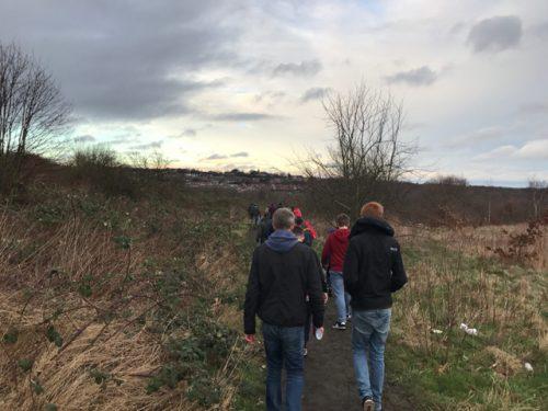 Walking through a field near Oakwell, home of Barnsley FC.