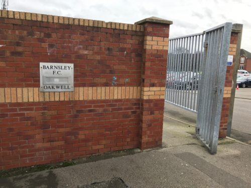 Brick wall with sign at Oakwell, home of Barnsley FC.