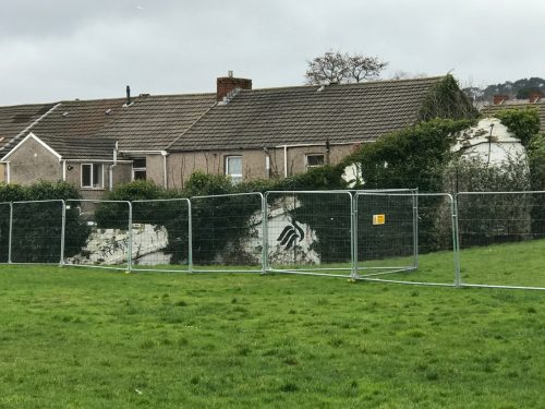 swansea city vetch field old wall covered in shrubbery