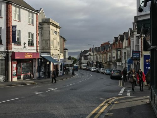 houses and businesses lining street mumbles south wales