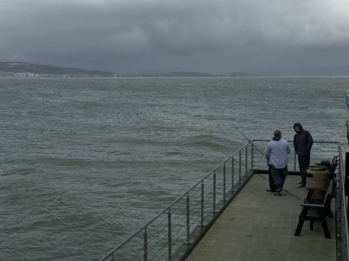 fishermen on mumbles pier south wales