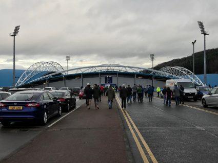 fans walking toward huddersfield town stadium