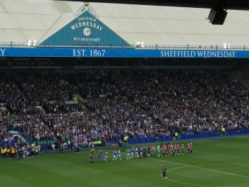 players lined up in front of fans at Hillsborough Stadium