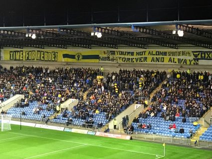 fans in stands at Oxford United