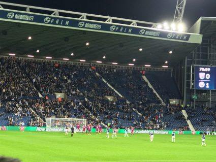 West Bromwich Albion fans watching a football game at The Hawthorns.