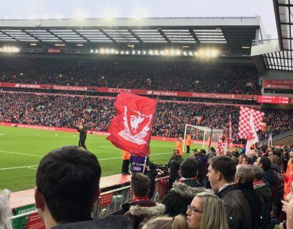 fans singing in Liverpool's kop