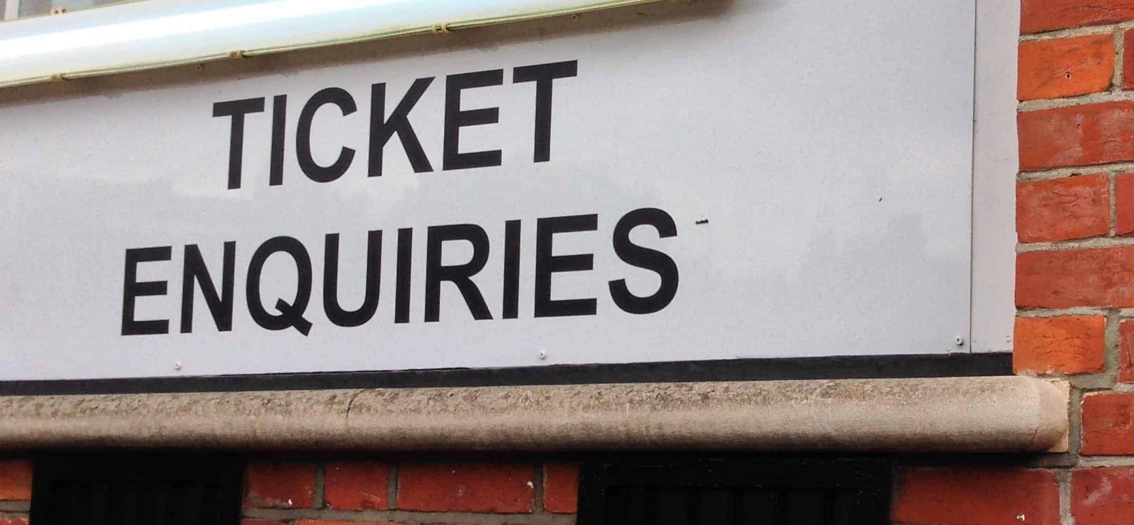 ticket enquiries sign at english football stadium