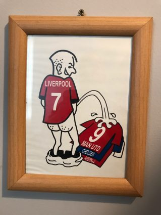 liverpool man united rivalry cartoon of liverpool player urinating on Man utd jersey