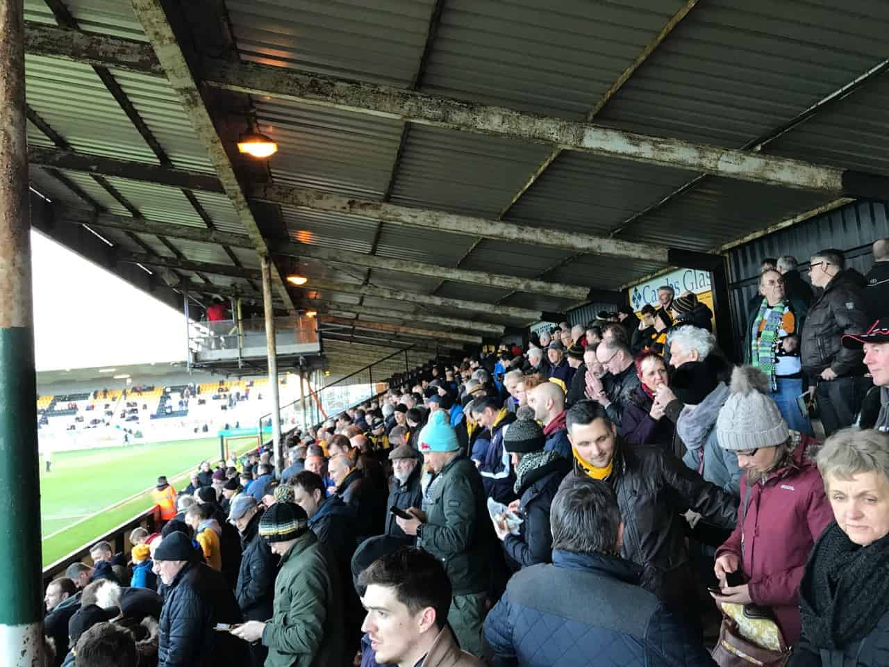 fans in the terraces at the abbey stadium