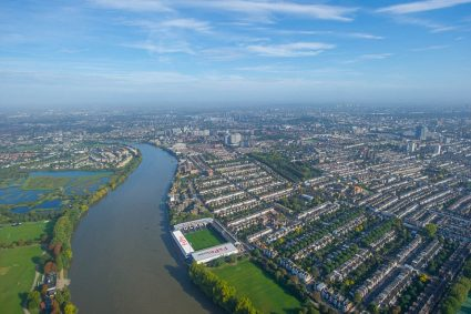aerial view Craven Cottage soccer stadium alongside river and city
