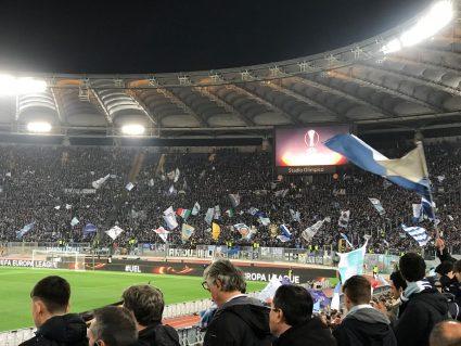 Lazio fans waving flags in La Curva Nord