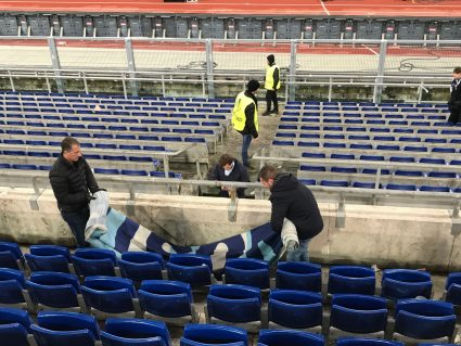 fans removing banner after game