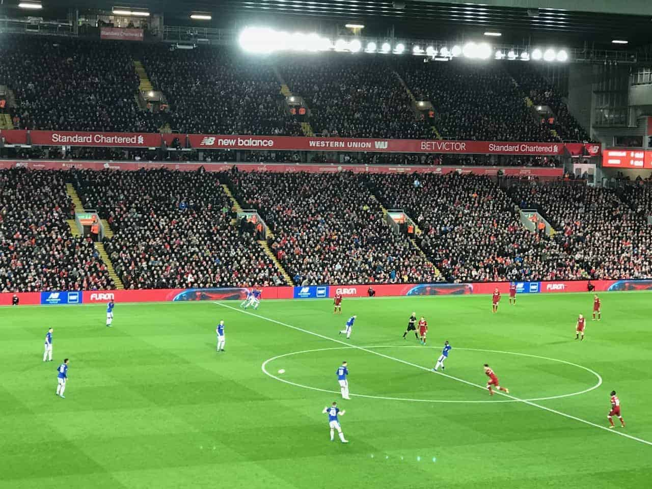 view of players on Liverpool Anfield soccer pitch from hospitality seat