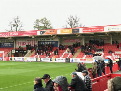 Stevenage fans in the away end at Whaddon Road, home of Cheltenham Town FC.