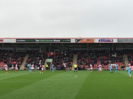 Kickoff in a game at Whaddon Road, home of Cheltenham Town FC.