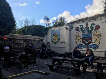 Outdoor beer garden behind a pub.