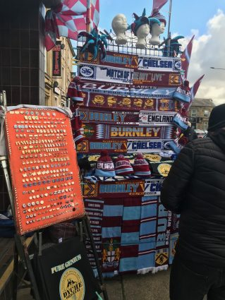 Vendor selling badges and scarves at Turf Moor, home of Burnley Football Club