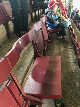 Claret-colored wooden seats at Turf Moor, home of Burnley Football Club