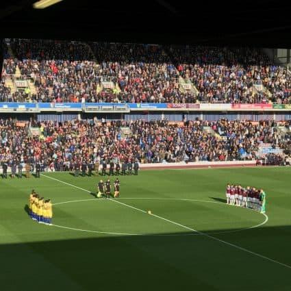 Teams having a minute's silence at Turf Moor, home of Burnley Football Club