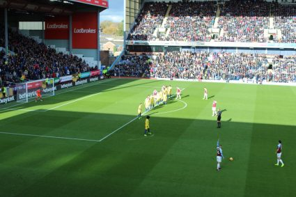 Players lining up for a free kick at Turf Moor, home of Burnley Football Club