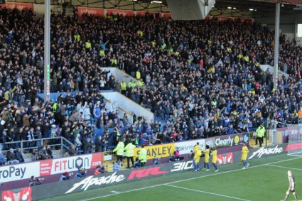 Chelsea fans celebrating a goal at Turf Moor, home of Burnley Football Club