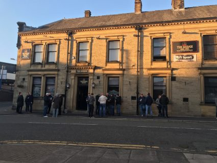 People drinking outside a pub in Burnley, Lancashire