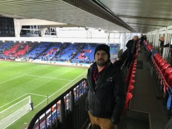 Crystal Palace fan in EPL ticket seats at Selhurst Park