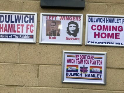 Football and political signs at Champion Hill, the home of Dulwich Hamlet FC in South London.