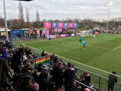 Players warm up for the game at Champion Hill, the home of Dulwich Hamlet FC in South London.
