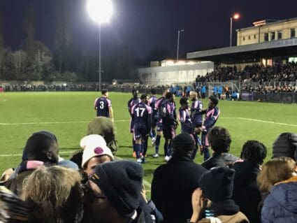 Players celebrate a goal at Champion Hill, the home of Dulwich Hamlet FC in South London.