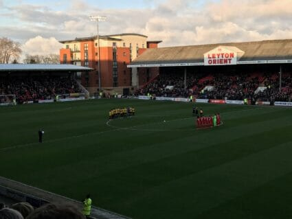 Players having a minute's silence on the pitch at Leyton Orient FC.