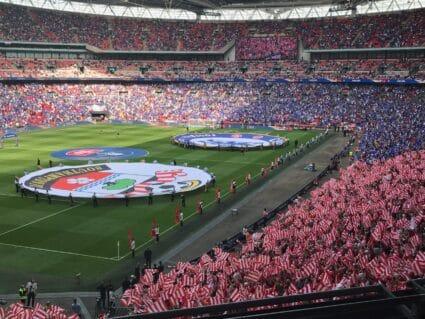 fans waving flags at fa cup semifinal wembley stadium