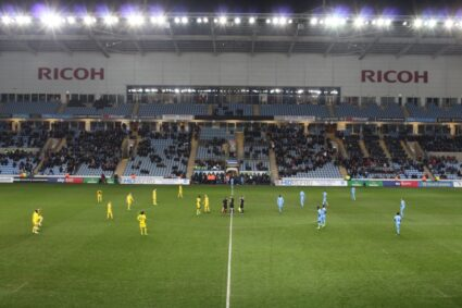 Players on the field for kickoff at Coventry City FC.