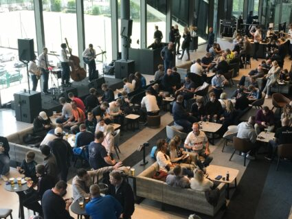 people in hospitality lounge at Premier League Tottenham Hotspur stadium