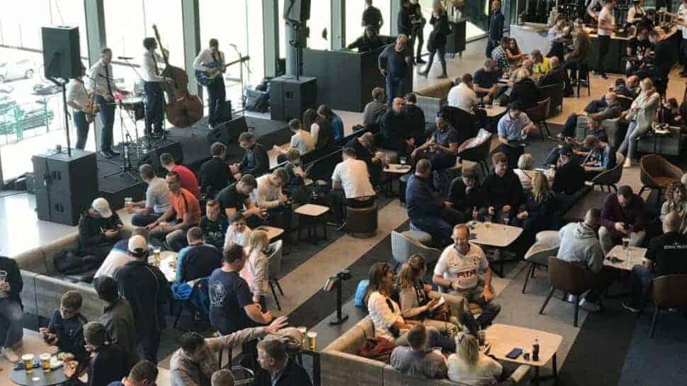people in lounge at Premier League Tottenham Hotspur stadium