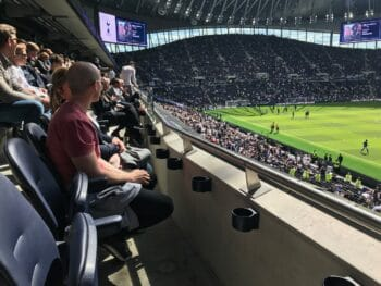fans sitting in Tottenham Hotspur club-level seats with view